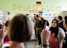 Syrians in Germany face fight fit for Kafka to see families