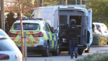 Man arrested after taking 2 people hostage at Britain bowling alley