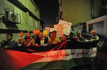Arab-Israelis protesting in Jaffa to mark the one-year-anniversary of the Israeli war on Gaza