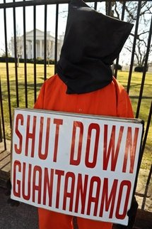 A protester calls for the closing of Guantanamo Bay