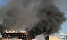Smoke billows from a building in Kabul
