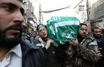 Mourners carry the coffin of Mahmud al-Mabhuh