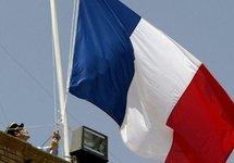 A French National Guardsman raising the national flag. (AFP/File/Saeed Khan)