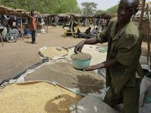 This photo, taken on 16th April, shows a man selling grain in Tibiri village, in southern Niger, an area which is facing a severe food shortage.