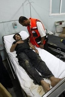 A medic attends to a wounded Palestinian youth at Al-Najar hospital in Rafah, in the southern Gaza strip.