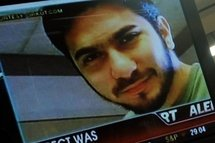 An image of Faisal Shahzad is shown on a television screen during a press conference at the US Justice Department in Washington.