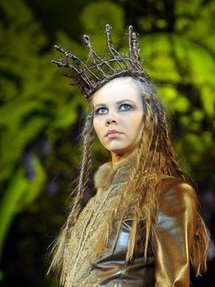 A model presents a creation by Jean Paul Gaultier during his fashion show at Kazansky railway station in Moscow.