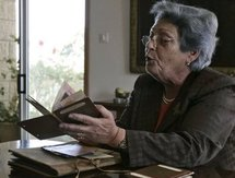 Diana Safieh shows old identity cards and photographs at her home in mostly Arab east Jerusalem, on 14th May.