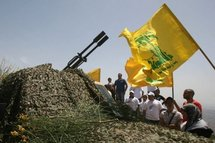 Lebanese tourists look at a Hezbollah anti-aircraft gun.