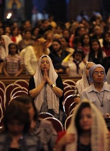 Egyptian Christians pray during the Easter Coptic Christian mass at Cairo's Abbassiya Cathedral in April 2010.