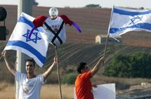 Israelis wave the national flag as they demonstrate in the coastal city of Netanya.
