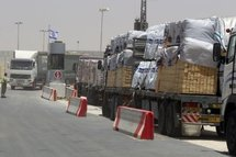 Trucks carrying wood bound for the Gaza Strip wait at the Kerem Shalom terminal.