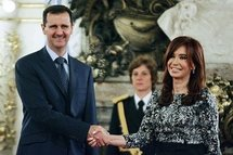 Syrian President Bashar al-Assad (left) shakes hands with Argentinean President Cristina Kirchner at a meeting in Buenos Aires.