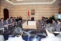 Syria cabinet resigns, Assad to address nation