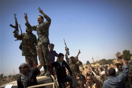 Libya rebels say town captured on path to Tripoli