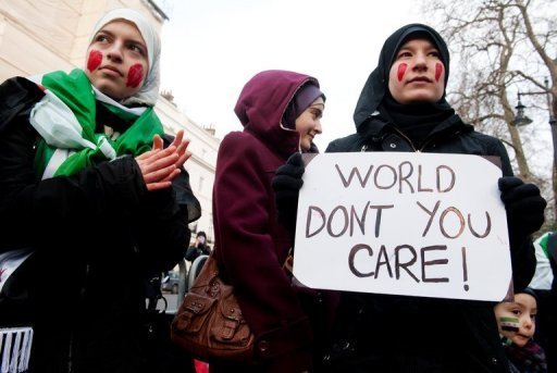 Protesters outside the Syrian embassy in London, on 4th February (AFP/ File, Leon Neal)