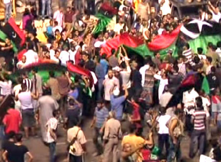Libya marks revolution day as leader issues warning
