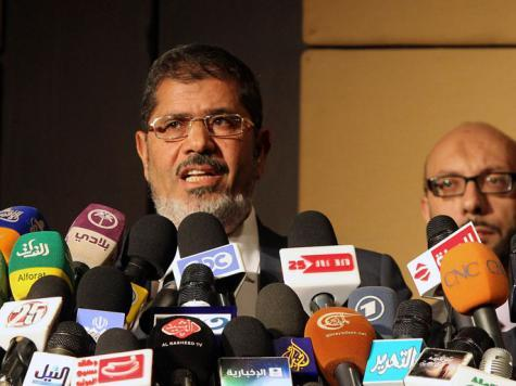 Egypt's Morsi pardons those convicted over 'revolution'