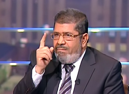 Egypt's Morsi promises democracy as protests rage