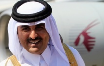 New Qatar emir extends hand to 'all', replaces PM