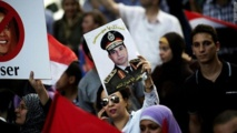 Egypt army chief urges rallies, Islamists warn of war