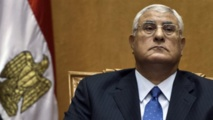 Egypt's Mansour says committed to election timetable