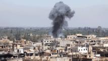 Air raids on market kill 40 as Syria regime hits back