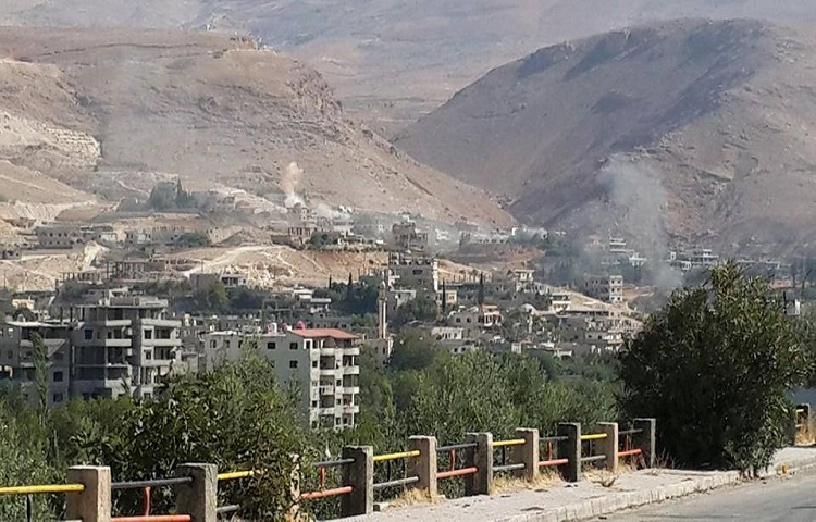 Deadly clashes grip flashpoint area near Syria capital