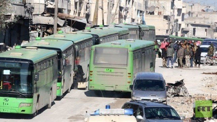 Buses evacuate hundreds from four besieged Syria towns