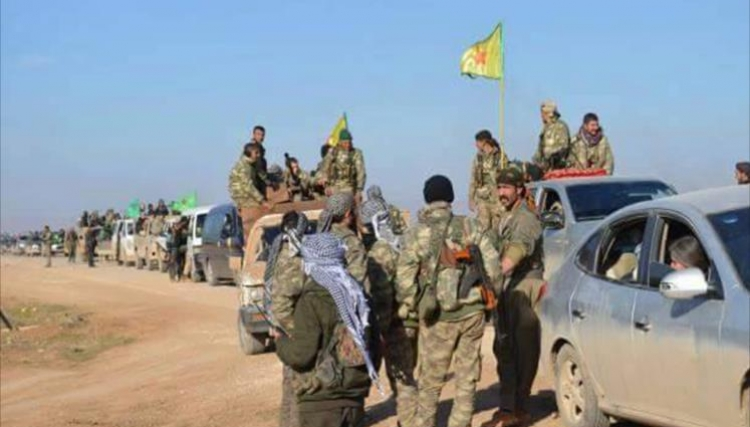 US-backed Syria force advances in Raqa, battles for base