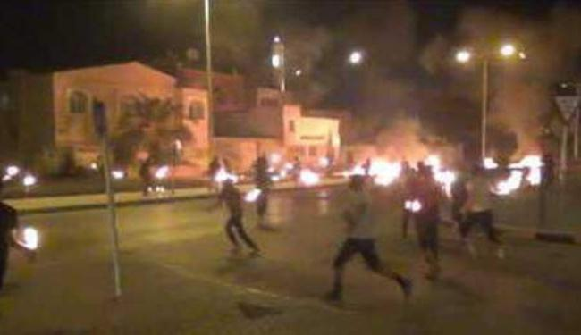 Bahrain protesters, police clash on uprising anniversary