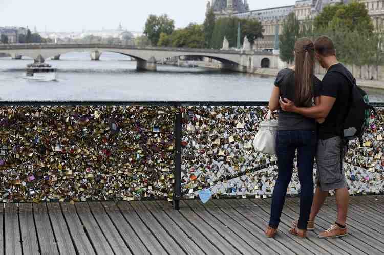 'Locks of love' Paris bridge reopens after railing collapse