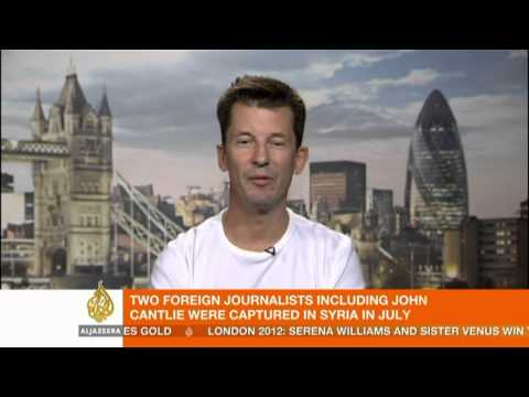 IS propaganda video places hostage in Kobane