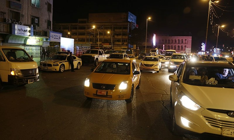 Iraqis fete curfew end with flags, horns and tyre smoke