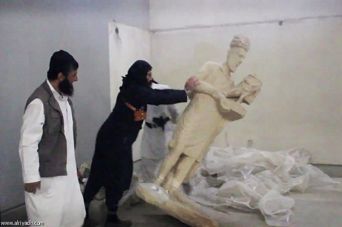 IS jihadists destroy ancient artefacts in Iraq: video