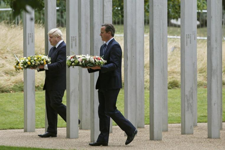 Britain remembers 2005 bombs with flowers and silence