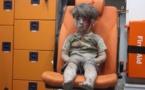 Photo of dazed Syrian boy symbolises Aleppo's plight