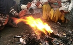 Indian teachers burn books to keep warm