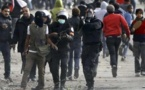 Egypt arrests  12 'Black Bloc' members at presidency