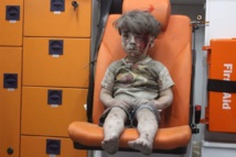 Photo of dazed Syrian boy symbolises Aleppo's plight