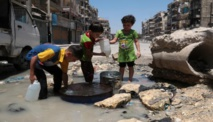 Four children among 11 dead in air strikes near Damascus