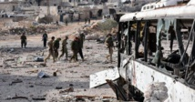Checkpoints, detours and signs of military push along the road to Aleppo