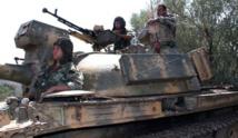 Syrian army says retakes key rebel area near Damascus
