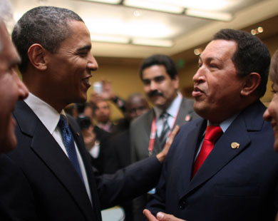 After handshake, Chavez offers Obama a book
