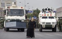 China raises Xinjiang death toll to 184
