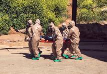 US says Assad may be preparing chemical attack, warns 'heavy price'