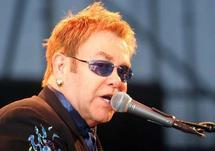 Sick Elton John postpones US gigs with Joel