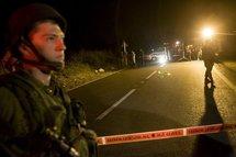 Israeli soldiers standing guard near the site where an Israeli settler was shot dead