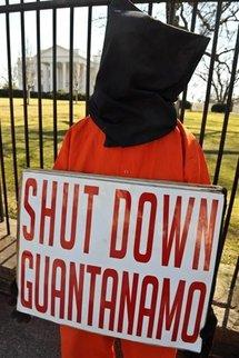 A protester calls for the closing of Guantanamo Bay