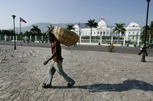A Haitian man walking past the Presidential Palace, in 2006